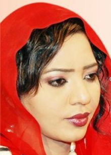 بالصور..مذيعة النيل الأزرق نسرين النمر تنشر صور لها مع الفنان محمد الأمين وصورة له وهو يبكي