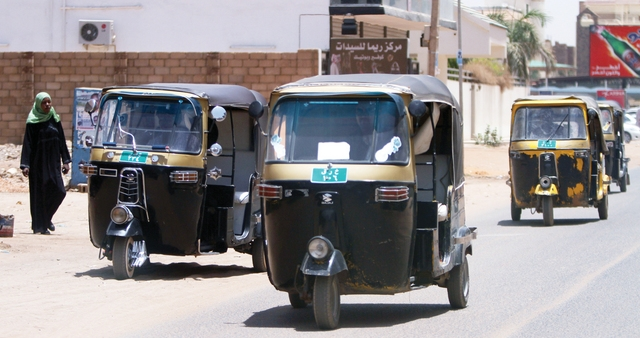 "Scooter-taxis known as ""tuk-tuk"" wait for customers in Khartoum on April 14, 2010. The three-wheeled transport, manufactured in India, provides locals and tourists alike with a charming alternative to regular taxis.AFP PHOTO/PATRICK BAZ"