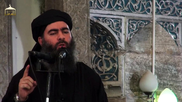 "(FILES) An image grab taken from a propaganda video released on July 5, 2014 by Al-Furqan Media allegedly shows the leader of the Islamic State (IS) jihadist group Abu Bakr al-Baghdadi, aka Caliph Ibrahim, adressing Muslim worshippers at a mosque in the militant-held northern Iraqi city of Mosul. Baghdadi, the self-proclaimed caliph of the brutal jihadist Islamic State (IS) group that has seized large chunks of Iraq and Syria, made the AFP shortlist of most influential people of 2014. AFP PHOTO / HO / AL-FURQAN MEDIA == RESTRICTED TO EDITORIAL USE - MANDATORY CREDIT ""AFP PHOTO / HO / AL-FURQAN MEDIA "" - NO MARKETING NO ADVERTISING CAMPAIGNS - DISTRIBUTED AS A SERVICE TO CLIENTS FROM ALTERNATIVE SOURCES, AFP IS NOT RESPONSIBLE FOR ANY DIGITAL ALTERATIONS TO THE PICTURE'S EDITORIAL CONTENT, DATE AND LOCATION WHICH CANNOT BE INDEPENDENTLY VERIFIED =="