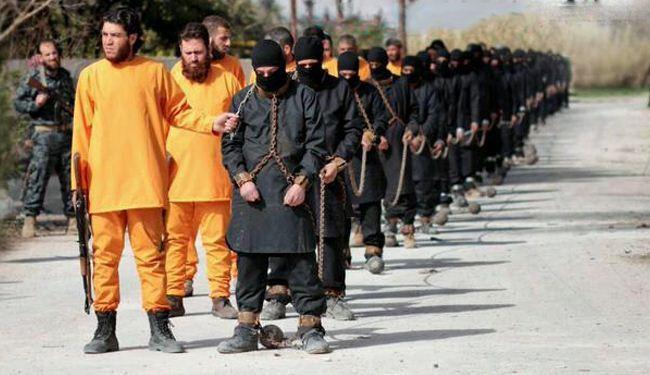 """""""جيش الاسلام"""" البرتقالي يعدم اسراه من داعش"""