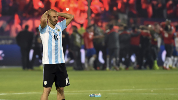 Argentina's midfielder Javier Mascherano gestures after losing to Chile the 2015 Copa America football championship, in Santiago, Chile, on July 4, 2015. Chile defeated 4-1 Argentina in the penalty shootout.   AFP PHOTO / NELSON ALMEIDA