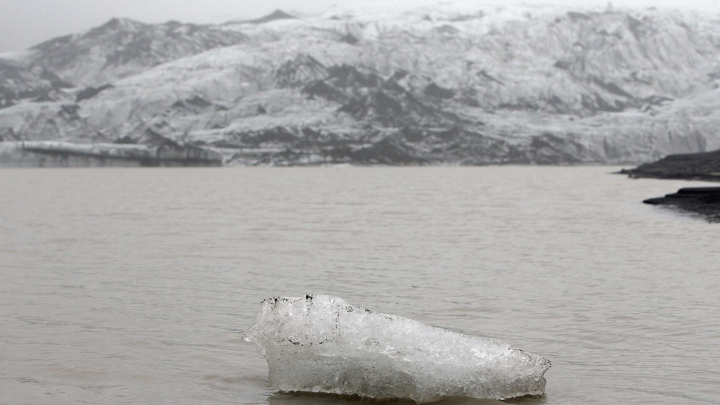 A view shows an ice flow floating on a lake in front of the Solheimajokull Glacier, where the ice has receded by more than 1 kilometer (0.6 miles) since annual measurements began in 1931, Iceland October 16, 2015. The French President went to the glacier to experience firsthand the damage caused by global warming, ahead of major U.N. talks on climate change in Paris this year. France is host to the World Climate Change Conference 2015 (COP21) from November 30 to December 11. Picture taken October 16, 2015.   REUTERS/Thibault Camus/Pool