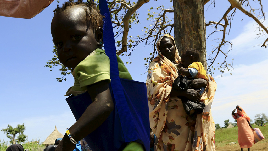 A child is weighed during visit by a European Union delegation, at an IDP camp in Azaza, east of Ed Damazine, capital of Blue Nile state, October 21, 2015.  The camp houses people displaced by war between Sudan People's Liberation Movement-North (SPLM-N) rebels and the Sudanese government.REUTERS/Mohamed Nureldin Abdallah