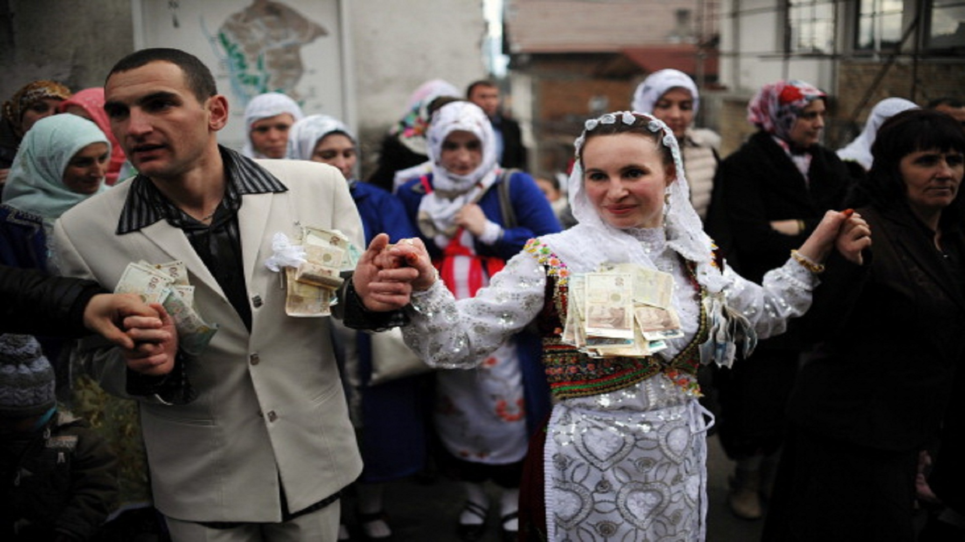 "Letve Osmanova, 21 and Refat Avdikov,21, dance during their wedding ceremony in the village of Ribnovo, in southwestern Bulgaria, on February 9, 2014. The people of this Bulgarian mountain village are famous for performing their unique wedding ceremonies in winter time only. The inhabitants of the village of Ribnovo are Bulgarian-speaking Muslims, sometimes referred to as ""Pomaks"" or ""people who have suffered"". Muslim Bulgarians are descendants of Christian Bulgarians who were forcibly converted to Islam by the Turks, during the 14th, 16th and the 18th century. AFP PHOTO / NIKOLAY DOYCHINOV        (Photo credit should read NIKOLAY DOYCHINOV/AFP/Getty Images)"