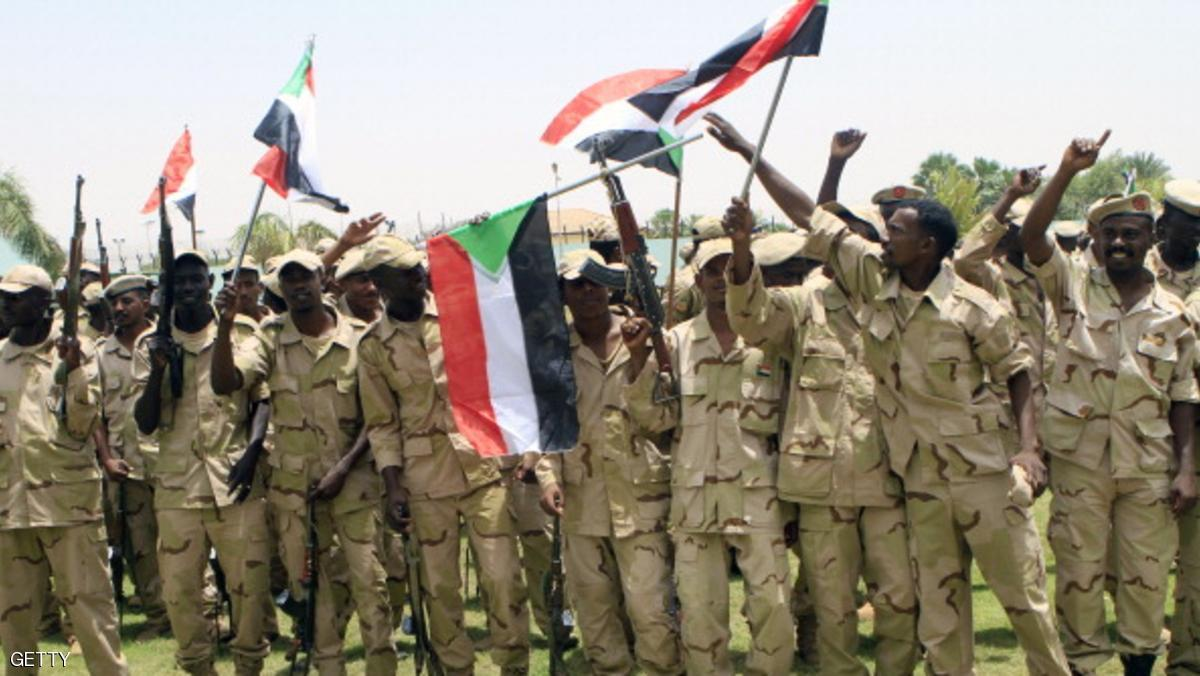 Waving the national flag, Sudanese soldiers rally in the capital Khartoum following a speech by Field Commander Brig. Mohammed Hamdan Hemaidti, on May 21, 2014, after troops from the controversial Rapid Support Forces said they seized a strategic area about 20 kilometres (12 miles) northeast of South Kordofan's state capital Kadugli. AFP PHOTO/ASHRAF SHAZLY        (Photo credit should read ASHRAF SHAZLY/AFP/Getty Images)