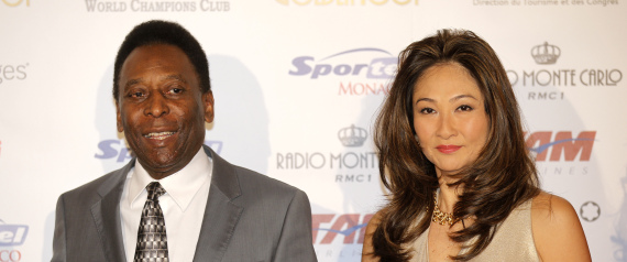 """Brazilian former soccer player Edison Arantes do Nascimento, better known as Pele and his girlfriend, arrive at the ceremony of the """"Golden Foot 2012"""" awards, in Monaco, Wednesday, Oct. 17, 2012. Pele will be awarded during the ceremony. (AP Photo/Lionel Cironneau)"""