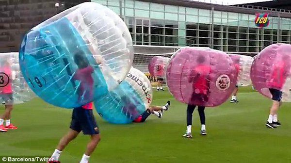 36B7437700000578 3715457 Barcelona squad enjoyed a game of bubble football in England on m 25 1469832923076
