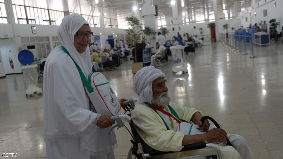 Algerian pilgrims arrive at Algiers airport on August 29, 2016, for their departure to the annual Hajj pilgrimage in the Islamic holy cities of Mecca and Medina in Saudi Arabia. The Hajj, the largest annual pilgrimage in the world, is the fifth pillar of Islam, a religious duty that must be carried out at least once in the lifetime of every able-bodied Muslim who can afford to do so. / AFP / RYAD KRAMDI        (Photo credit should read RYAD KRAMDI/AFP/Getty Images)