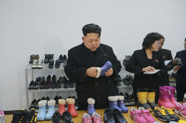 North Korean leader Kim Jong Un (L) provides field guidance to the Ryuwon Shoes Factory in this undated photo released by North Korea's Korean Central News Agency (KCNA) in Pyongyang January 21, 2015. REUTERS/KCNA (NORTH KOREA - Tags: POLITICS BUSINESS TPX IMAGES OF THE DAY) ATTENTION EDITORS - THIS PICTURE WAS PROVIDED BY A THIRD PARTY. REUTERS IS UNABLE TO INDEPENDENTLY VERIFY AU NTICITY, CONTENT, LOCATION OR DATE THIS IMAGE THIS PICTURE IS DISTRIBUTED EXACTLY AS RECEIVED BY REUTERS, AS A SERVICE TO CLIENTS FOR EDITORIAL USE ONLY. NOT FOR SALE FOR MARKETING OR ADVERTISING CAMPAIGNS. THIS IMAGE HAS BEEN SUPPLIED BY A THIRD PARTY. IT IS DISTRIBUTED, EXACTLY AS RECEIVED BY REUTERS, AS A SERVICE TO CLIENTS. NO THIRD PARTY SALES. NOT FOR USE BY REUTERS THIRD PARTY DISTRIBUTORS. SOUTH KOREA OUT. NO COMMERCIAL OR EDITORIAL SALES IN SOUTH KOREA