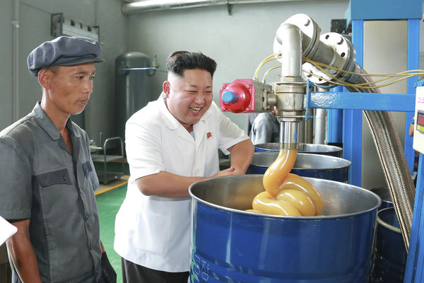 North Korean leader Kim Jong Un smiles during a visit to the Chonji Lubricant Factory, in this undated photo released by North Korea's Korean Central News Agency (KCNA) in Pyongyang August 6, 2014. REUTERS/KCNA (NORTH KOREA - Tags: POLITICS IMAGES OF THE DAY) ATTENTION EDITORS – THIS PICTURE WAS PROVIDED BY A THIRD PARTY. REUTERS IS UNABLE TO INDEPENDENTLY VERIFY THE AUTHENTICITY, CONTENT, LOCATION OR DATE OF THIS IMAGE. FOR EDITORIAL USE ONLY. NOT FOR SALE FOR MARKETING OR ADVERTISING CAMPAIGNS. NO THIRD PARTY SALES. NOT FOR USE BY REUTERS THIRD PARTY DISTRIBUTORS. SOUTH KOREA OUT. NO COMMERCIAL OR EDITORIAL SALES IN SOUTH KOREA. THIS PICTURE IS DISTRIBUTED EXACTLY AS RECEIVED BY REUTERS, AS A SERVICE TO CLIENTS