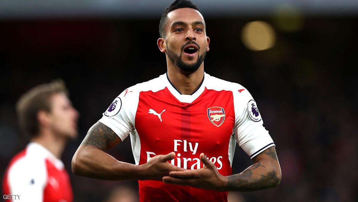 LONDON, ENGLAND - NOVEMBER 27: Theo Walcott of Arsenal celebrates scoring his sides second goal during the Premier League match between Arsenal and AFC Bournemouth at Emirates Stadium on November 27, 2016 in London, England.  (Photo by Clive Rose/Getty Images)